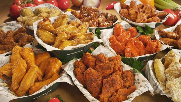 A table full of traditional chicken wings from Wingstop.