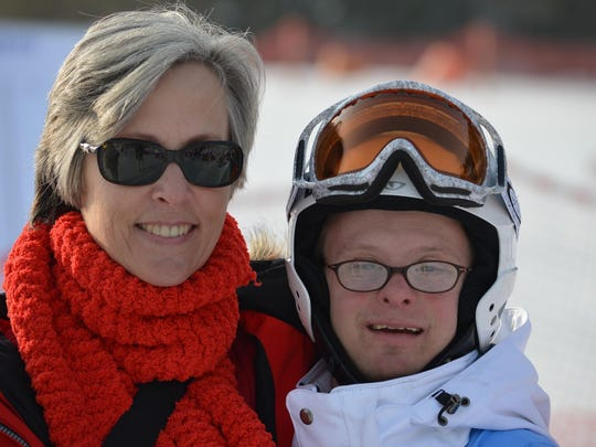 Anne Knodle and son Robbie in South Korea, where Robbie competed in the Special Olympics World Winter Games in 2013.