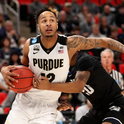 Purdue forward Vincent Edwards (12) looks to make a