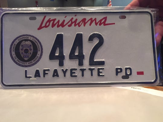 A special license plate bearing 442, the badge number of slain Lafayette Police Cpl. Michael Middlebrook.