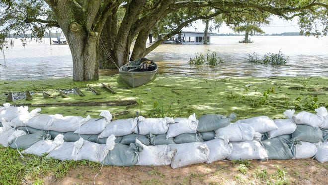 Lake Arthur residents receive help from the Army National Guard to build sand bag wall to keep flood waters from the city.