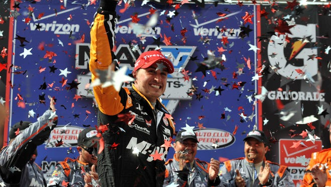Jun 27, 2015; Fontana, CA, USA; IndyCar driver Graham Rahal (15) celebrates his victory of the MAVTV 500 at Auto Club Speedway. Mandatory Credit: Gary A. Vasquez-USA TODAY Sports