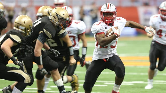 Somers Messiah Horne (23) breaks away from Greece Athena defenders on a second half touchdown run, during the New York State Class A championship game at the Carrier Dome in Syracuse, N.Y. Nov. 25, 2016. Somers won the game 25-17.