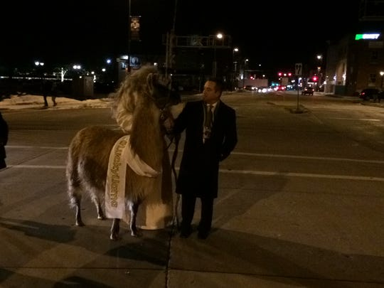Green Bay Mayor Jim Schmitt leads the Lucky Llama across