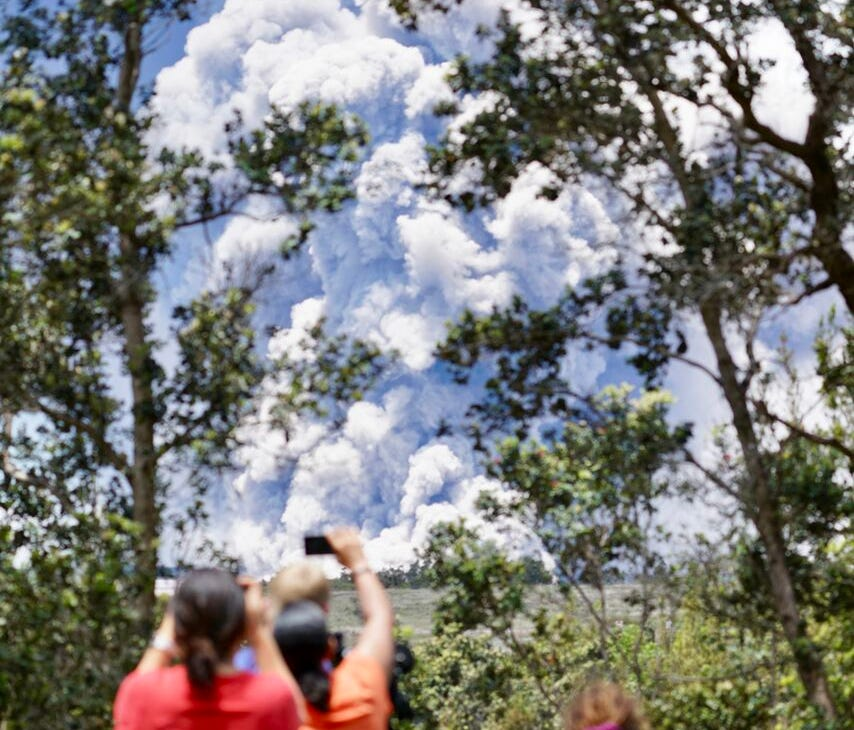 Onlookers take photos of the Kilauea volcanic eruption Tuesday on the Big Island of Hawaii.