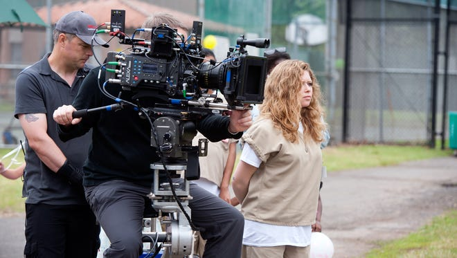 "Natasha Lyonne on the set of Netflix's ""Orange is the New Black"" Season 3. Photo Credit: JoJo Whilden for Netflix"