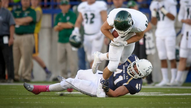 Montana State linebacker Grant Collins makes a shoestring tackle against Cal Poly earlier this season in Bozeman.