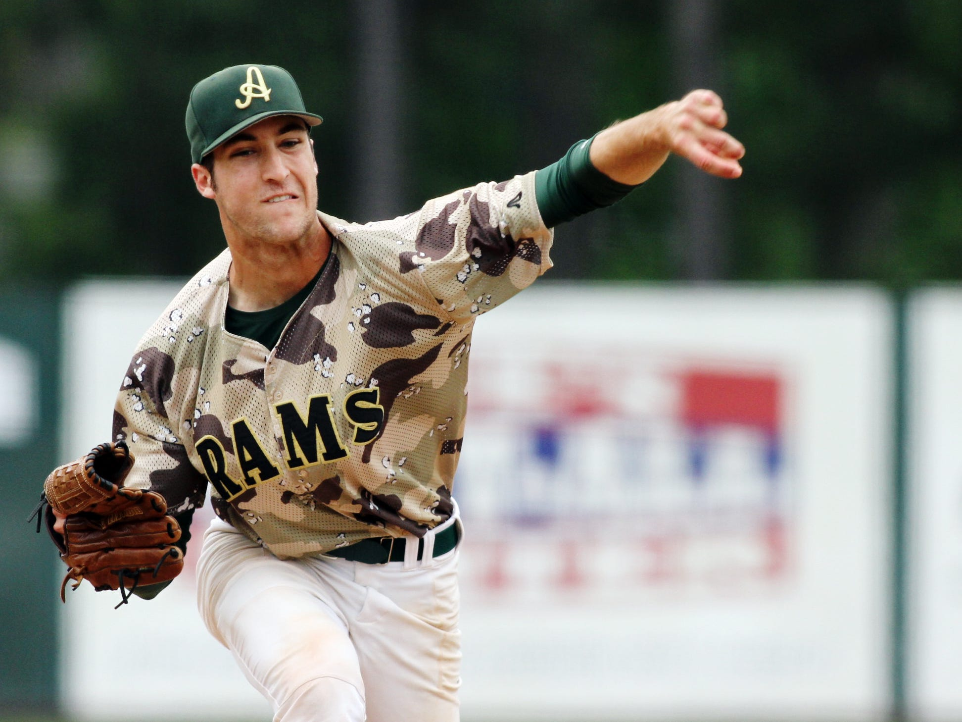 Acadiana's Derek Boutin lifts the Wreckin' Rams to an opening round win over St. Amant on Tuesday at Tigue Moore Field.