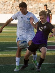 Dixie High's Oscar Quintero (21) fights for the ball with Desert Hills' Colby Hendrix (12) during the 2018 state semifinals. Dixie went on to lose 2-1 but have compiled an 11-1 region record, a share of the region title  with Desert Hills and momentum headed into the 2019 playoffs.