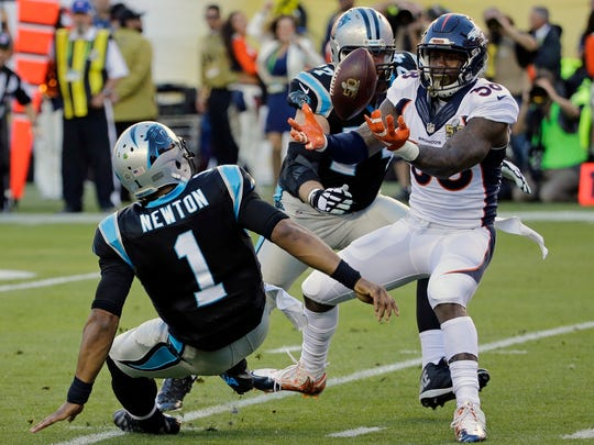 Denver Broncos' Von Miller (58) strips the ball from Carolina Panthers' Cam Newton (1) during the first half of Super Bowl 50 on Feb. 7, 2016, in Santa Clara, Calif.
