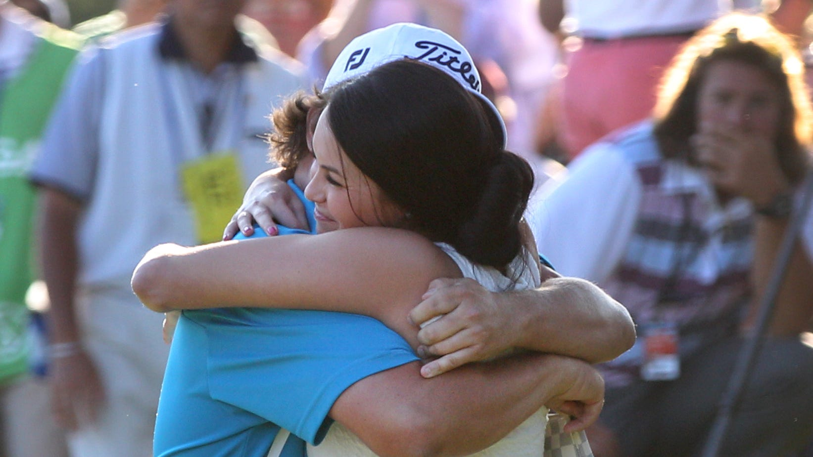 Jason Dufner hugs his wife, Amanda Dufner, after he won the 95th PGA Championship at Oak Hill in Pittsford, NY August 11, 2013.