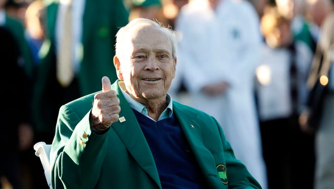 Apr 7, 2016: Honorary starter Arnold Palmer gives a thumbs up as he is seated along the first tee during the first round of the 2016 The Masters golf tournament at Augusta National Golf Club.