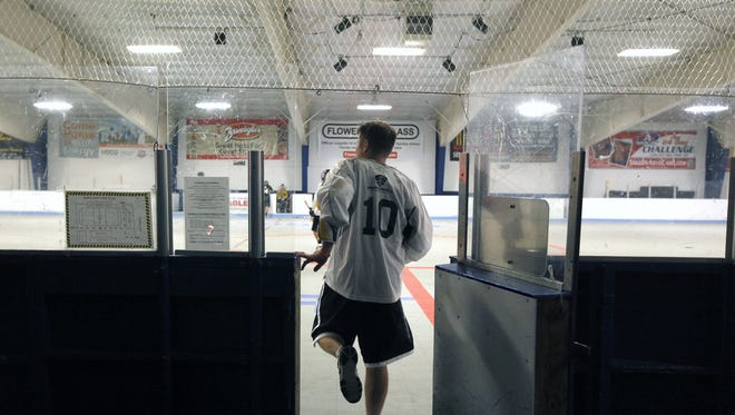 Craig Whipple returns from a quick water break while coaching the Rochester Jayhawks indoor team at the Lakeshore Rink in Greece on June 4.