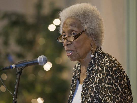 "Poet Mari Evans reads her poem ""Celebration"" during"