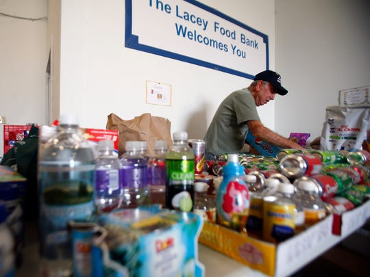 Lacey Food Bank volunteer Dick Sansone, Lacey, works in the group's warehouse.
