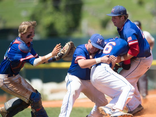 Macon East dog piles onto pitcher Kohner Massey (16) after winning the AISA Class AA State Championship after defeating Clarke Prep 6-0 in the second game of the series on Tuesday, May 9, 2017, at Paterson Field in Montgomery, Ala.