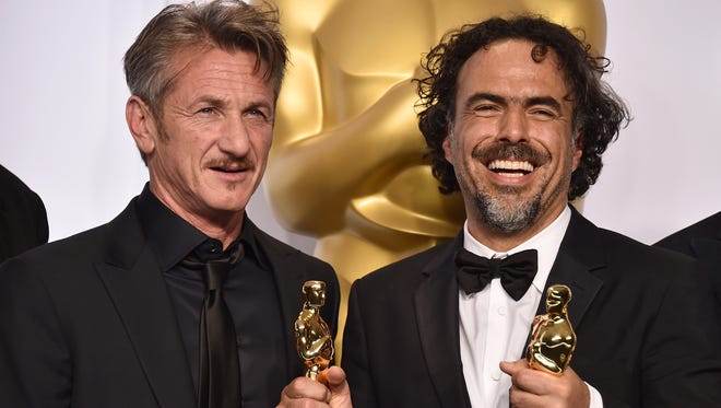 In this Feb. 22, 2015 file photo, presenter Sean Penn, left, and filmmaker Alejandro Inarritu pose in the press room after winning multiple awards including best original screenplay, best director and best picture for 'Birdman' at the Oscars in Los Angeles.