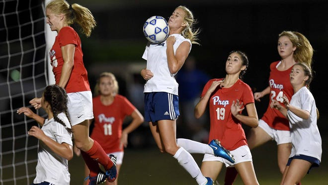 Jackson Academy's Emily McNair (center) receives the corner kick and redirects it into the goal for a 2-0 Lady Raiders lead over Jackson Prep on Monday, October 10, 2016,  in the MAIS Division I Girl's State Soccer Championship at Jackson Prep in Flowood, Miss.