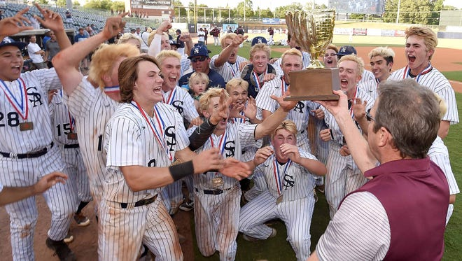 The St. Andrew's Saints receive the Class 3A trophy after beating North Pontotoc on Thursday, May 17, 2018, in the MHSAA State Baseball Championships at Trustmark Park in Pearl, Miss.