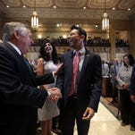 Louisiana Gov. Bobby Jindal , center, laughs as he is greeted by Sen. Daniel Martiny, R-10th Dist., as he arrives to address the opening session of the Louisiana State Legislature in Baton Rouge, on April 13, 2015. Behind is Jindal's wife, Supriya Jindal.