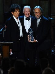 From left, President Jimmy Carter, Bob Dylan and Neal