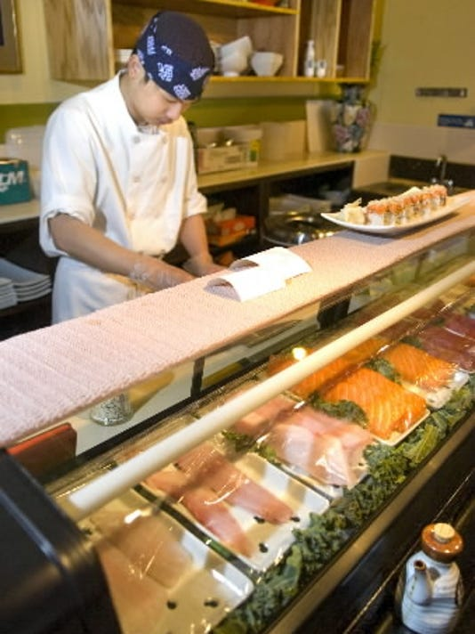 Sushi chef Jerry Zheng prepares lunch at Wild Ginger in Springettsbury Township. The restaurant serves Neo-Asian Japanese cuisine   a fusion of Japanese, Chinese and Thai foods with nuances from all over the globe.