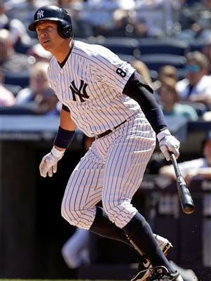 New York Yankees designated hitter Alex Rodriguez hits an RBI double during the fourth inning of a baseball game against the Tampa Bay Rays, Sunday, April 24, 2016, in New York.