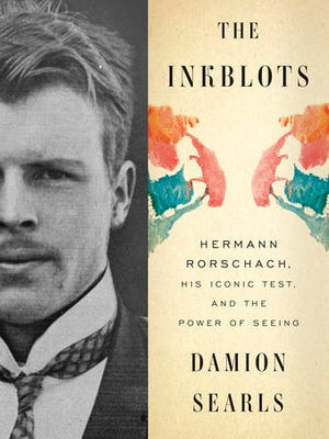 "This cover image released by Crown shows ""The Inkblots: Hermann Rorschach, His Iconic Test, and the Power of Seeing,"" by Damion Searls."