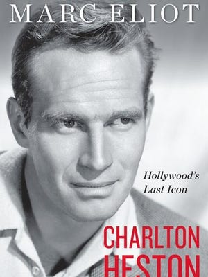 "This cover image released by Dey Street shows ""Charlton Heston: Hollywood's Last Icon,"" by Marc Eliot."