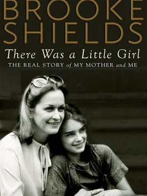 "This image released by Dutton shows the cover of the book, ""There Was a Little Girl: The Real Story of My Mother and Me,"" by Brooke Shields. (AP Photo/Dutton)"