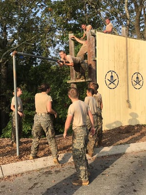 Cadets navigate obstacles during the Gauntlet event at the Raiders State Competition.