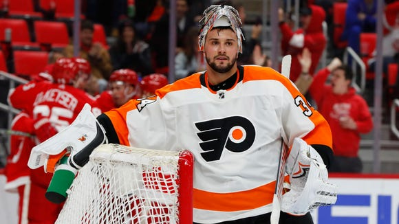 Philadelphia Flyers goaltender Petr Mrazek (34) plays against the Detroit Red Wings in the second period of an NHL hockey game Tuesday, March 20, 2018, in Detroit. (AP Photo/Paul Sancya)