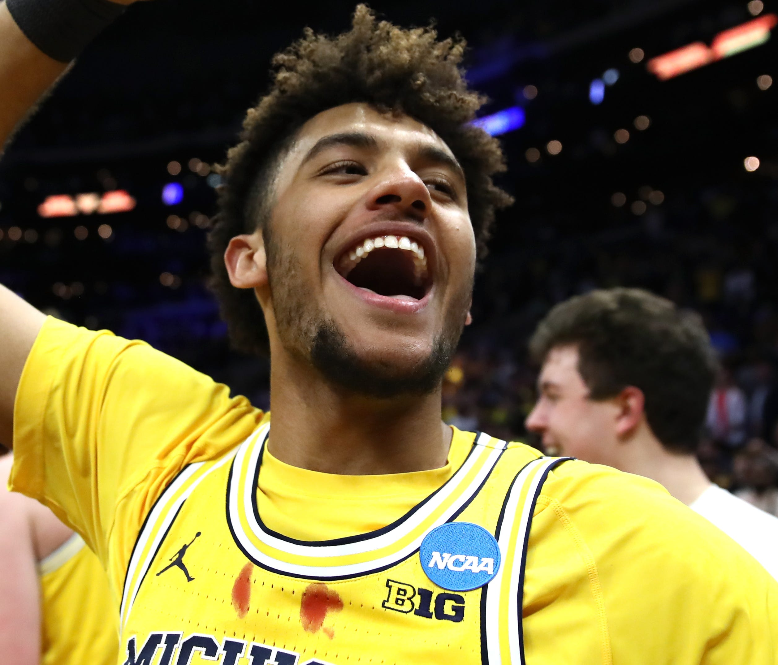 Michigan's Isaiah Livers celebrates after the Wolverines beat Florida State in the West Regional Final.
