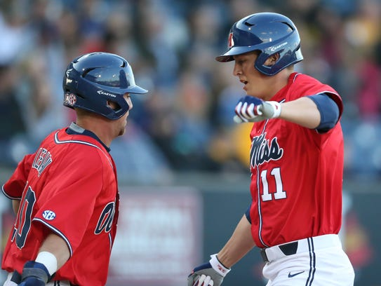 Ole Miss's Chase Cockrell (11) is congratulated by Ole Miss's Tyler Keenan (10) after hitting a home run against Southern Mississippi at Trustmark Park in Pearl on Tuesday, April 20, 2018. Keenan was 3 of 4 with 4 RBIs including a 2-run home run vs. Auburn Friday night. Photo by Keith Warren