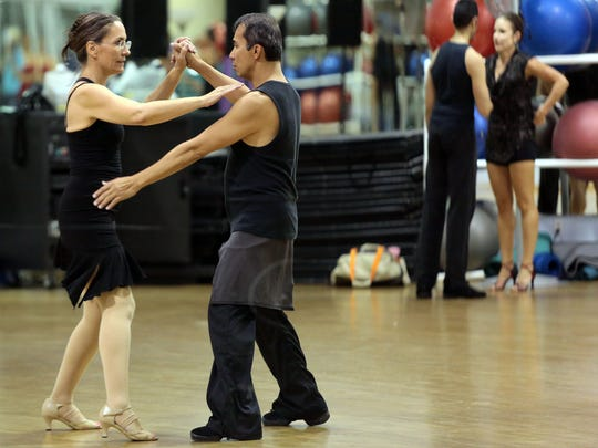 Desert Magazine editor Mary Silverman rehearses with professional dancer Dennis Gimenez on Wednesday, November 5, 2014 in Palm Springs, Calif. The pair, who are performing samba and paso doble numbers, are competing in the 4th Annual Dancing with the Desert Stars event on November 14. The event benefits 100 Women at Desert AIDS Project.