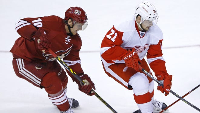 Arizona Coyotes left wing Martin Erat (left), Detroit Red Wings left wing Tomas Tatar fight for the puck during the second period of their NHL game on Feb. 7, 2015, in Glendale.
