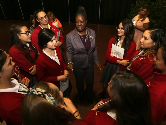 Sybrina Fulton visits with Loretto Academy students at the conclusion of Thursday's 2016 YWCA Women's Luncheon at the convention center.