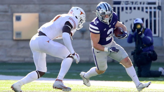 Kansas State cornerback Justin Gardner (6) misses a tackle against Texas running back Bijan Robinson (5) during Saturday's game at Bill Snyder Family Stadium. Robinson rushed for 172 yards and three touchdowns in the Longhorns' 69-31  victory.