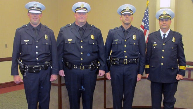 West Chester Township Police Officers, from left Joseph Beck, Michael Quinn, Jamie Hensley, and Brian Rebholz, all received promotions.