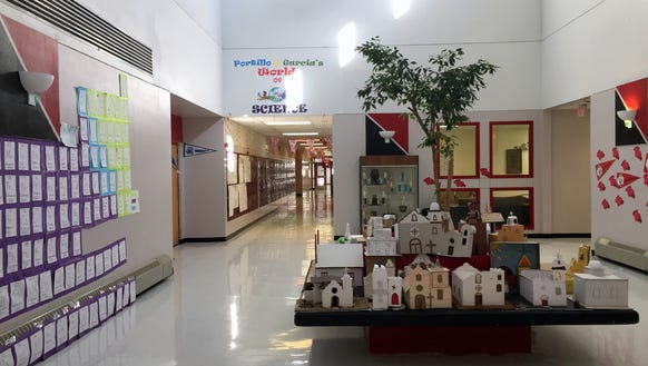 Students' dioramas of missions sit in the Tornillo