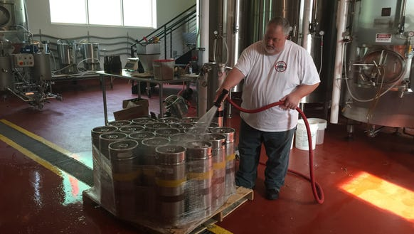 Genesee Brew House brewmaster Dean Jones washes off