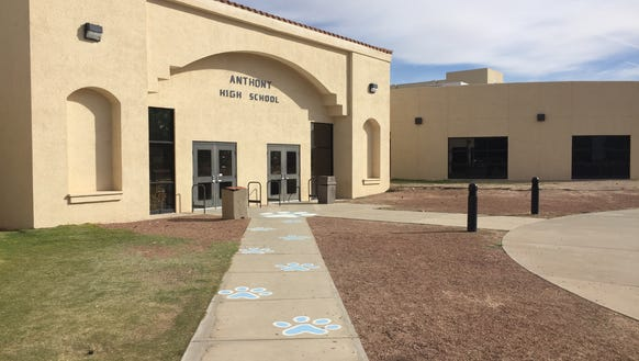 Wildcat paw prints line the walkway outside Anthony