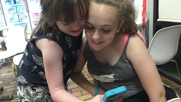 Sophie Stern, 13, takes a selfie with her sister, Annabelle.
