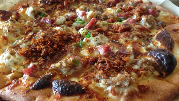 Pizza Artista offers build-your-own, fast-fired pizzas.