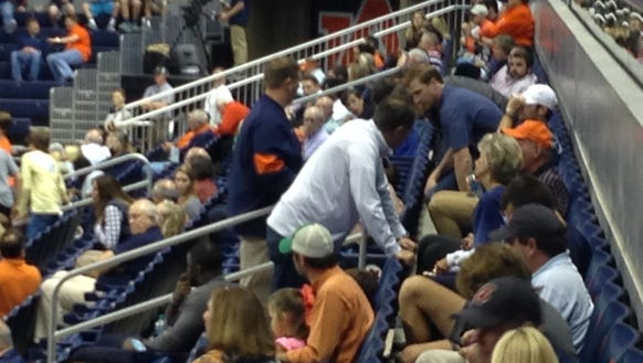 Auburn head coach Gus Malzahn (white) talks to fans