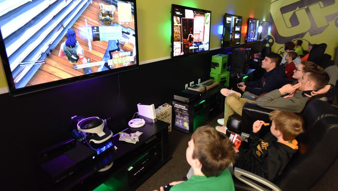Fortnite, an online game that combines kill-em-all thrill with the whimsy of a cartoon dreamland, has become an obsession among teenagers. Fans gathered on Friday at Gamers Paradise in River Vale to play the post-apocalyptic game together.