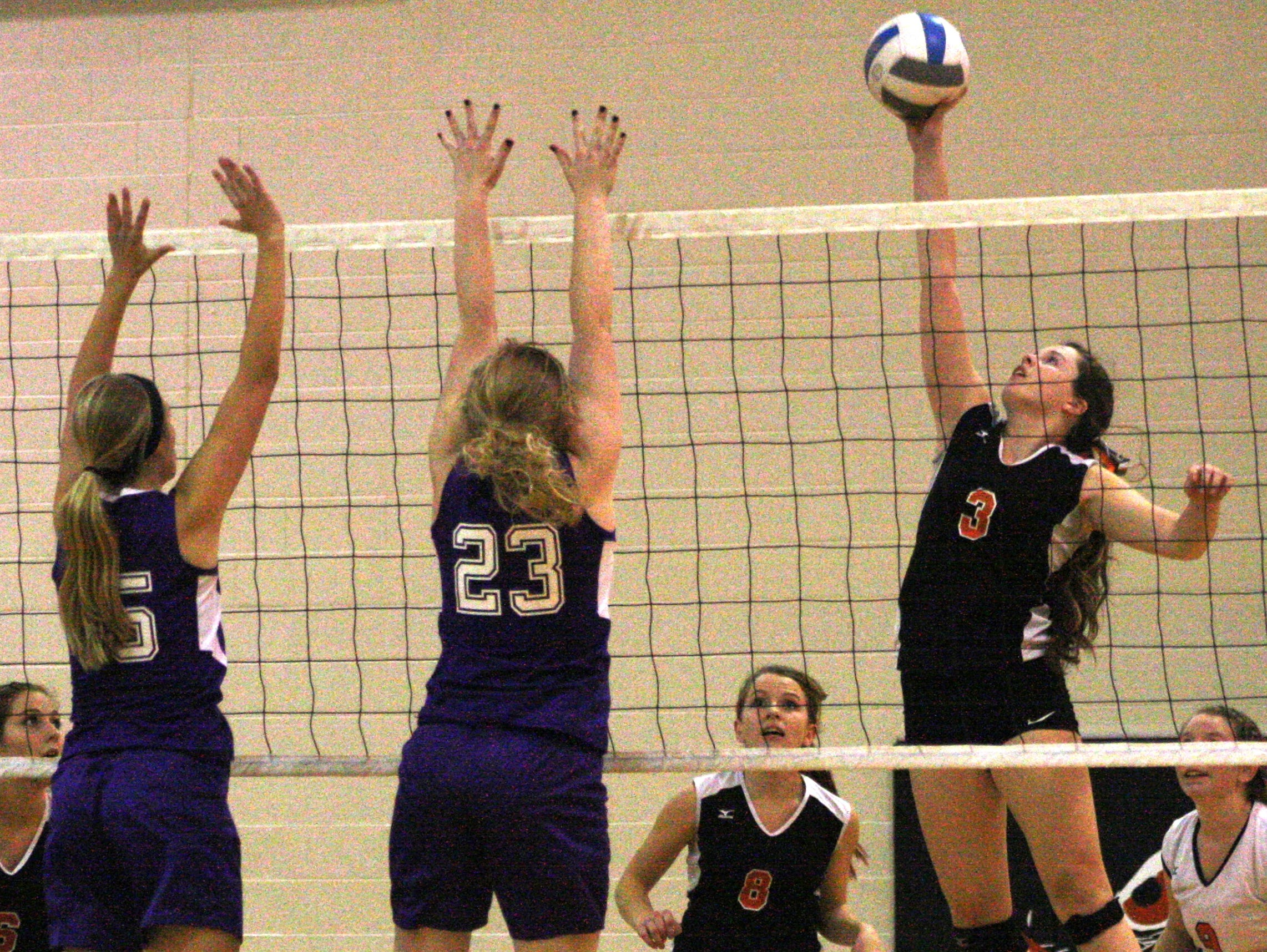 Huron Valley Lutheran's Madison Dest knocks down one of her 23 kills Thursday night.