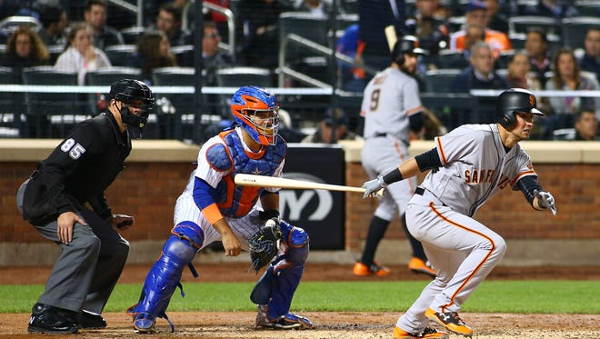 San Francisco Giants second baseman Joe Panik (12) singles against the New York Mets during the fifth inning at Citi Field on Monday