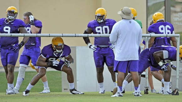 Former LSU defensive tackled Mickey Johnson (96) is