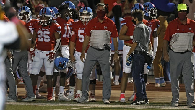 Monterey coach Wayne Hutchinson looks onto the field during the game Friday, Oct. 2, 2020, at PlainsCapital Park at Lowrey Field in Lubbock, Texas.